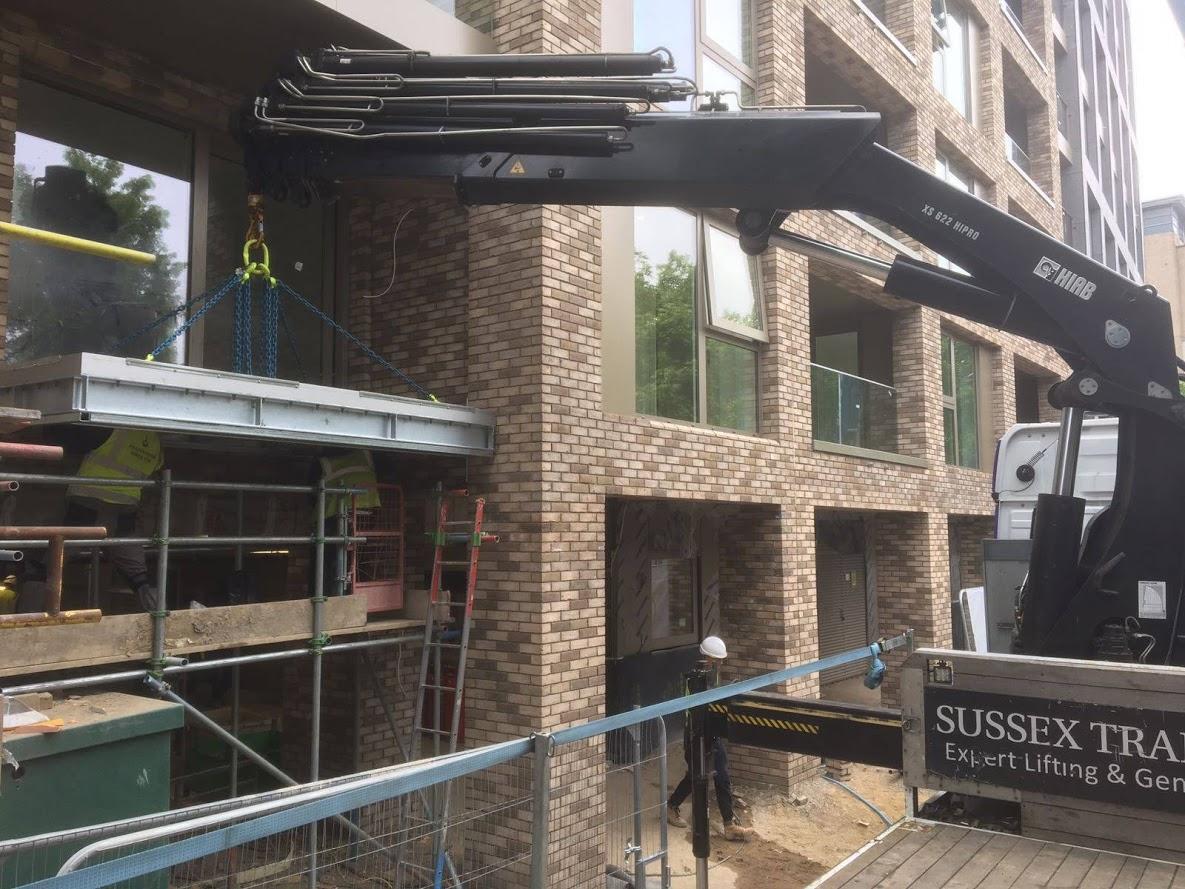 lifting beams into building